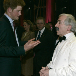 Britain's Prince Harry talks to actor Andrew Sachs backstage at the Wimbledon Theatre after a charity performance in aid of the Prince's Trust charity in 2008.