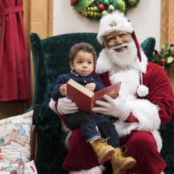 A Santa of color may be coming to town: Larry Jefferson relishes his role at the Bloomington, Minn., Mall of America. The mall hired him for a four-day stint and found him to be a hit with youngsters like Kingston Strong.