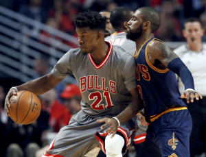 Chicago guard Jimmy Butler, left, backs into Cleveland guard Kyrie Irving during the first half of the Bulls' 111-105 win Friday night in Chicago. Butler led the Bulls with 26 points while the Cavaliers lost their third straight game.