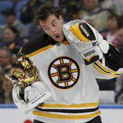 Boston goalie Tuukka Rask reacts after being hit with a high stick during the first period against Buffalo. Rask went on to make 35 saves and lead to Bruins to a 2-1 win. (Associated Press/Jeffrey T. Barnes)