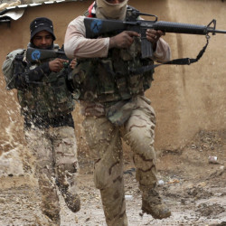 Iraqi soldiers secure streets in a village recently liberated from Islamic State militants.