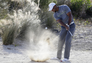 Tiger Woods hits from the sand on the 14th hole during the third round at the Hero World Challenge on Saturday in Nassau, Bahamas. (Associated Press/Lynne Sladky)