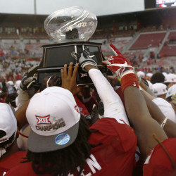 Oklahoma holds up the Big 12 Trophy after defeating Oklahoma State 38-20 in an NCAA college football game, Saturday, Dec. 3, 2016, in Norman, Okla. ()