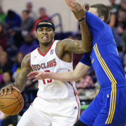 Marcus Georges-Hunt of the Maine Red Claws drives to the basket against Scott Wood of the Santa Cruz Warriors on Saturday at the Portland Expo. The Red Claws rallied for a 115-106 win. (Shawn Patrick Ouellette/Staff Photographer)