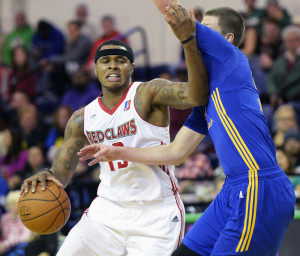 Marcus Georges-Hunt of the Maine Red Claws drives to basket against Scott Wood of the Santa Cruz Warriors on Saturday at the Portland Expo. The Red Claws rallied for a 115-106 win. (Shawn Patrick Ouellette/Staff Photographer)