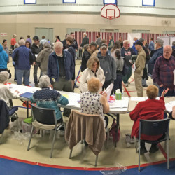Voters wait in line to cast ballots at the Boys and Girls Club of Greater Gardiner in this Nov. 8 file photo. A Gardiner city council candidate says the club may have jeopardized its nonprofit status by publicly backing another candidate for council.