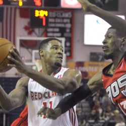 Maine's Demetrius Jackson, left, looks to make a pass while being defended by Raptors 905's Antwaine Wiggins during the Red Claws' 102-89 loss on Sunday.