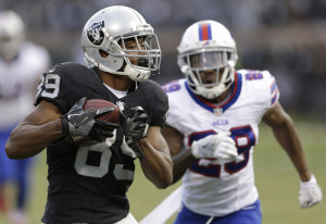 Amari Cooper of the Oakland Raiders runs past Kevon Seymour of the Buffalo Bills to score on a 37-yard pass play Sunday during Oakland's 38-24 victory at home.