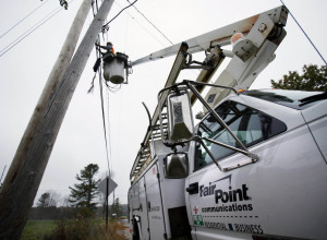 Peter Adams, a telephone line splicer for FairPoint Communications, works from a bucket lift in Freeport in October 2009.