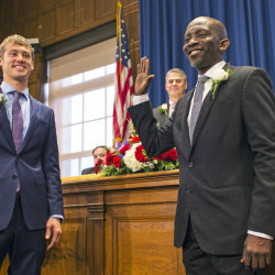 "Newly elected City Councilors Brian Batson, left, and Pious Ali are sworn in during a ceremony Monday at City Hall. It is ""probably the most diverse council in Portland history - maybe Maine history,"" Mayor Ethan Strimling said. The nine councilors range in age from 25 to 65."