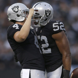 The Oakland Raiders, with quarterback Derek Carr, left, and defensive end Khalil Mack, are tied with the Pats for the AFC's best record, but Carr's injury may be a postseason factor.