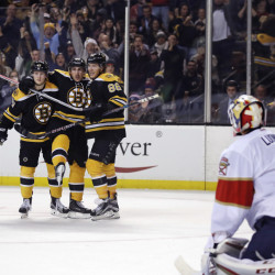 Bruins right wing David Pastrnak (88) is congratulated by teammates Torey Krug, left, and Brad Marchand after his goal against Panthers goalie Roberto Luongo in the second period Monday night in Boston. The Bruins went on to win 4-3 on an overtime goal by Pastrnak.