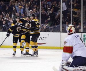 Bruins right wing David Pastrnak (88) is congratulated by teammates Torey Krug (47) and Brad Marchand after his goal against Panthers goalie Roberto Luongo in the second period Monday night in Boston. The Bruins went on to win 4-3 on an overtime goal by Pastrnak.