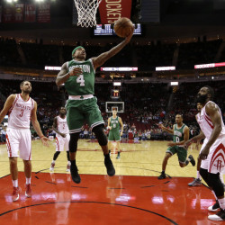 The Celtics' Isaiah Thomas goes up for a layup as Houston Rockets Ryan Anderson (3) and James Harden, right, watch in the first half of Monday night's game in Houston. Harden had 37 points to lead the Rockets.