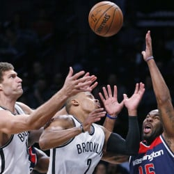 Brook Lopez, left, and Randy Foye of the Brooklyn Nets contend for a loose ball Monday night with Marcus Thornton of the Washington Wizards during the Wizards' 118-113 victory.