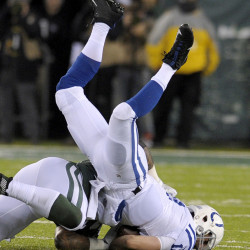 Quarterback Andrew Luck of the Indianapolis Colts, right, is sacked by Leonard Williams of the New York Jets during the first half of the Colts' 41-10 victory Monday night.