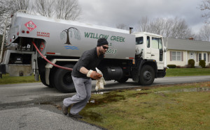 Jeremy Riordan, owner of Willow Creek Fuels, delivers oil in Saco.