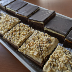 Peanut butter brownies and mint brownies at Foley's Bakery in Portland. Early renditions of the brownie were flavored with molasses rather than chocolate. An early version of the chocolate brownie, known as the Bangor Brownie, was said to have been invented by a Bangor housewife when a cake she was making for company failed to rise.