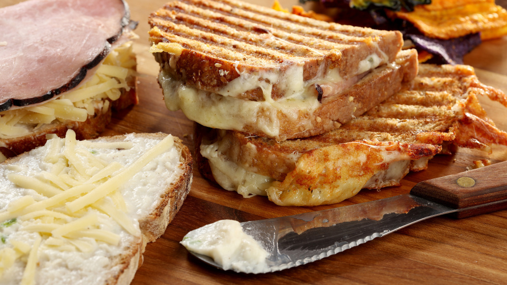 A cheese sauce enriched with cream cheese and plenty of herbs boosts a croque-monsieur.
