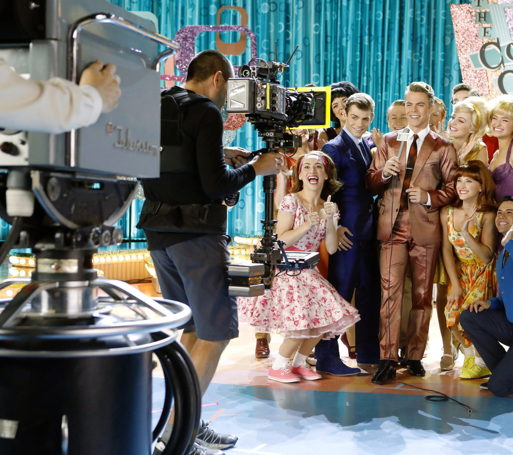 "Garrett Clayton plays Link Larkin, center left in blue suit, and Derek Hough is Corny Collins, center right, during a recent rehearsal of ""Hairspray Live!"" Hough will stay in character after a musical number to extol the virtues of Oreo cookies in a live ad."