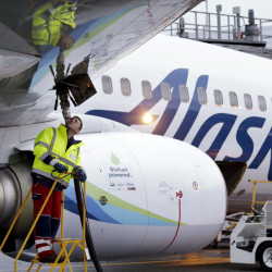 An Alaska Airlines jet is refueled in SeaTac, Wash. The Alaska-Virgin America merger is the latest in a series of deals that have reduced the number of competing airlines in the U.S.