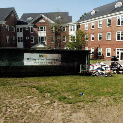 A dumpster loaded with items from students leaving for the summer was ignited on the Waterville campus in May. Three former students pleaded guilty to criminal mischief charges.