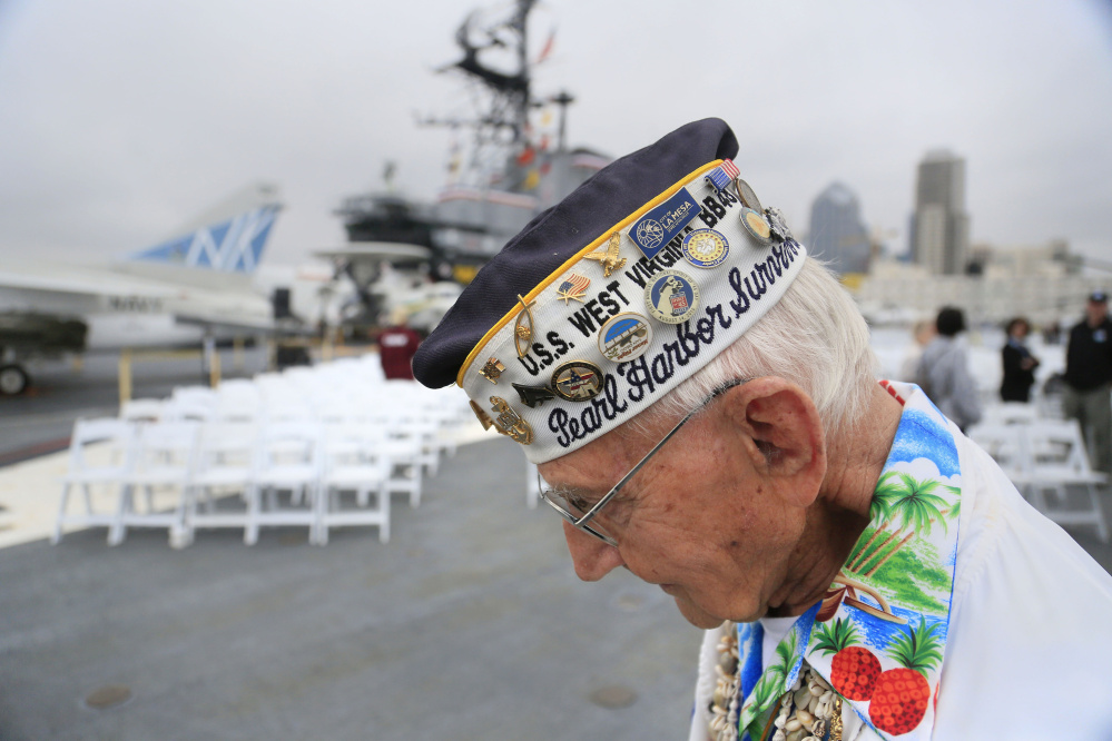Pearl Harbor survivor Stuart Hedley, 95, says he dove from the battleship USS West Virginia 75 years ago and swam to shore underwater to avoid building-high flames.