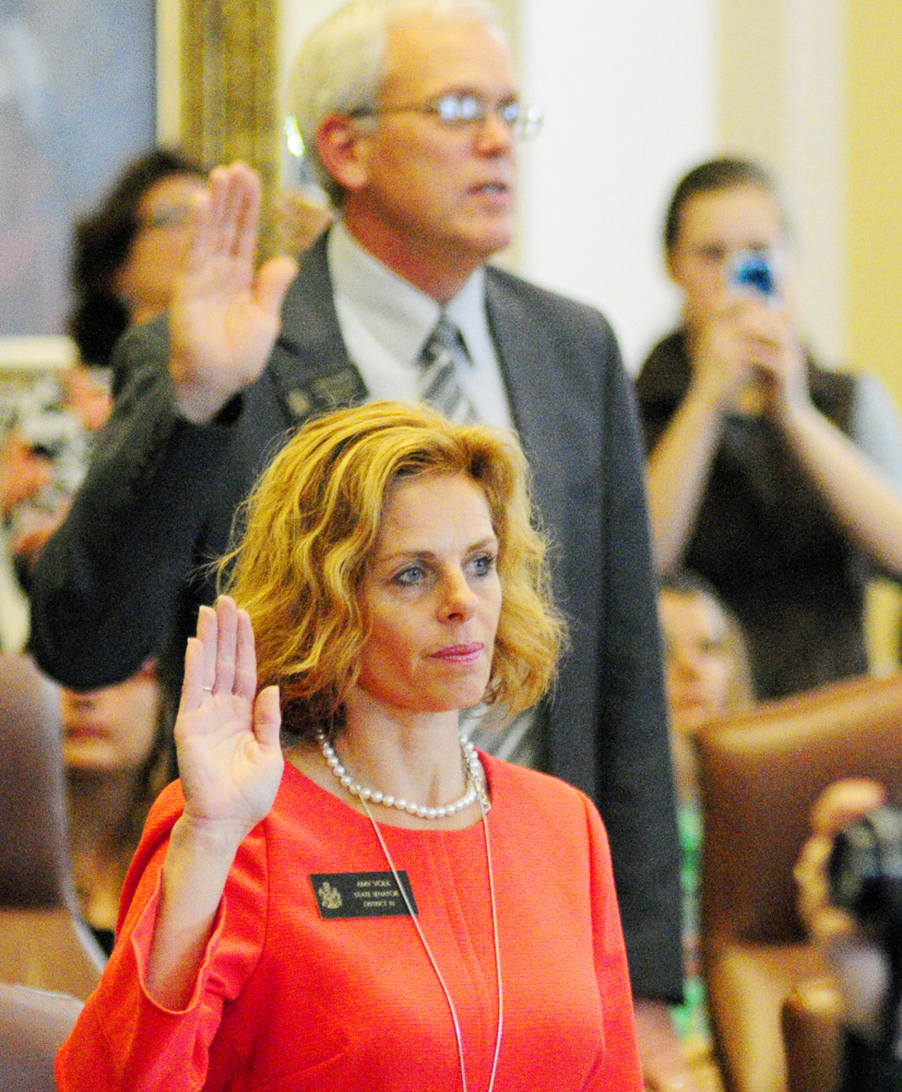 Elected Sens. Scott Cyrway, R-Benton, and Amy Volk, R-Scarborough, are sworn in Wednesday by the governor.