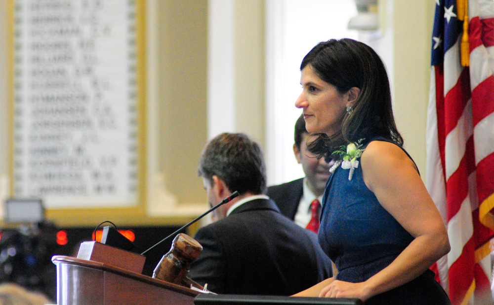 New Speaker of the House Sara Gideon, D-Freeport, hammers the chamber to order. Sen. Mike Thibodeau, R-Winterport, was elected to a second term as Senate president Wednesday.
