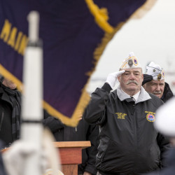 Rod Anderson, of Amvets Post 25, salutes the flag during a remembrance ceremony at Fort Allen Park in Portland to mark the 75th anniversary of the attack on Pearl Harbor.