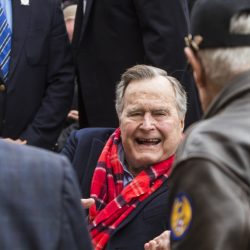 Former President George H.W. Bush greets World War II veterans at the conclusion of a Pearl Harbor remembrance ceremony at the George Bush Presidential Library Dec. 7, 2016, in College Station, Texas.
