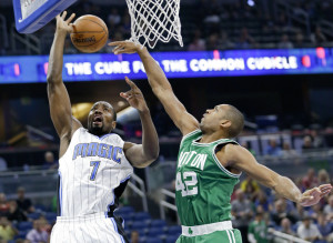 Orlando's Serge Ibaka is fouled as he goes to the basket against Boston's Al Horford in the first half Wednesday night in Orlando, Fla.