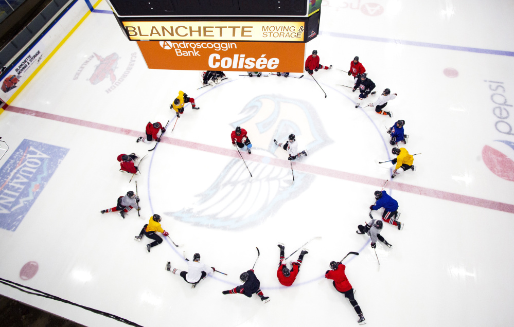 The Scarborough boys' hockey team stretches before practice at the Androscoggin Bank Colisee in Lewiston, which is the home rink for the Red Storm this winter after the closure of MHG Ice Arena in Saco.