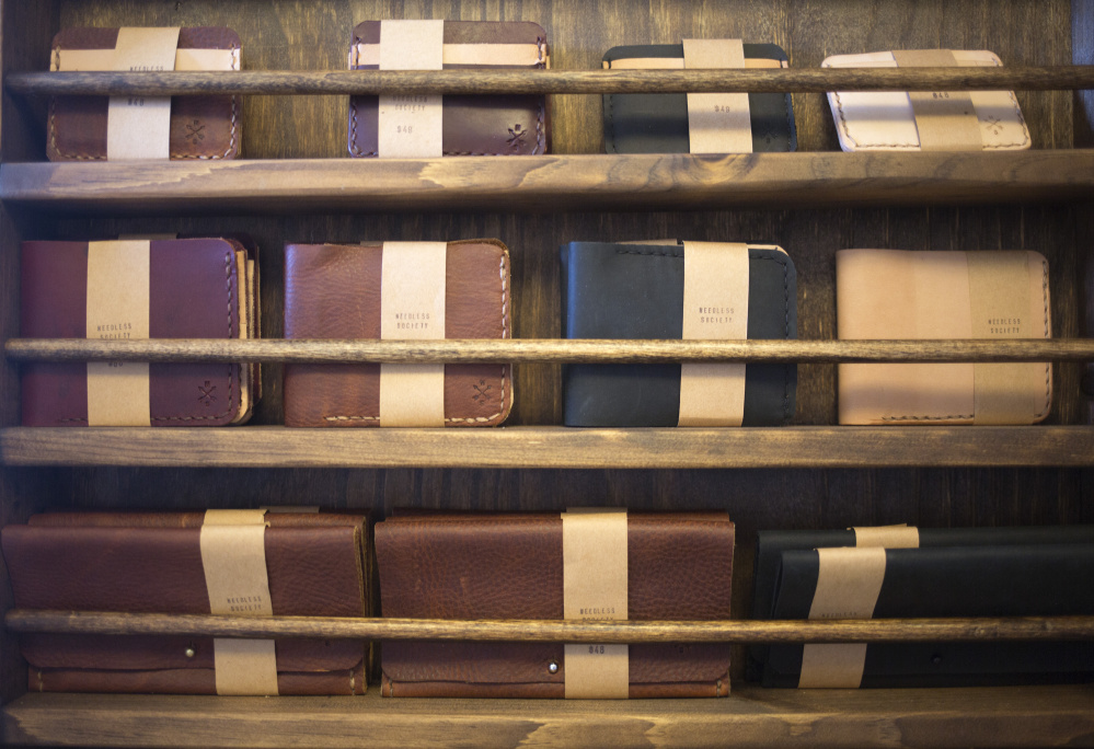 Handmade leather wallets at Rance and Phoebe Pope's workshop.