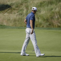 Dustin Johnson, right, was the victim of the old golf rule while challenging for the U.S. Open championship last June. His ball moved on the green without Johnson touching it, and when the round was over, he discovered he had been charged with a one-shot penalty. Johnson still won the tournament.