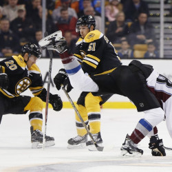 Colorado's Patrick Wiercioch trips up while battling Boston's Riley Nash, 20, and Ryan Spooner in the first period of Thursday night's game at Boston.