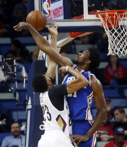 Joel Embiid, right, of the Philadelphia 76ers blocks a shot by Anthony Davis of the New Orleans Pelicans during the first half of the 76ers' 99-88 victory Thursday night.