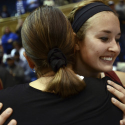 Elon's Maddie McCallie, right, hugs Joanne P. McCallie, her mother and Duke head coach, after Duke's 68-61 victory over the Phoenix on Thursday night in Durham, N.C.