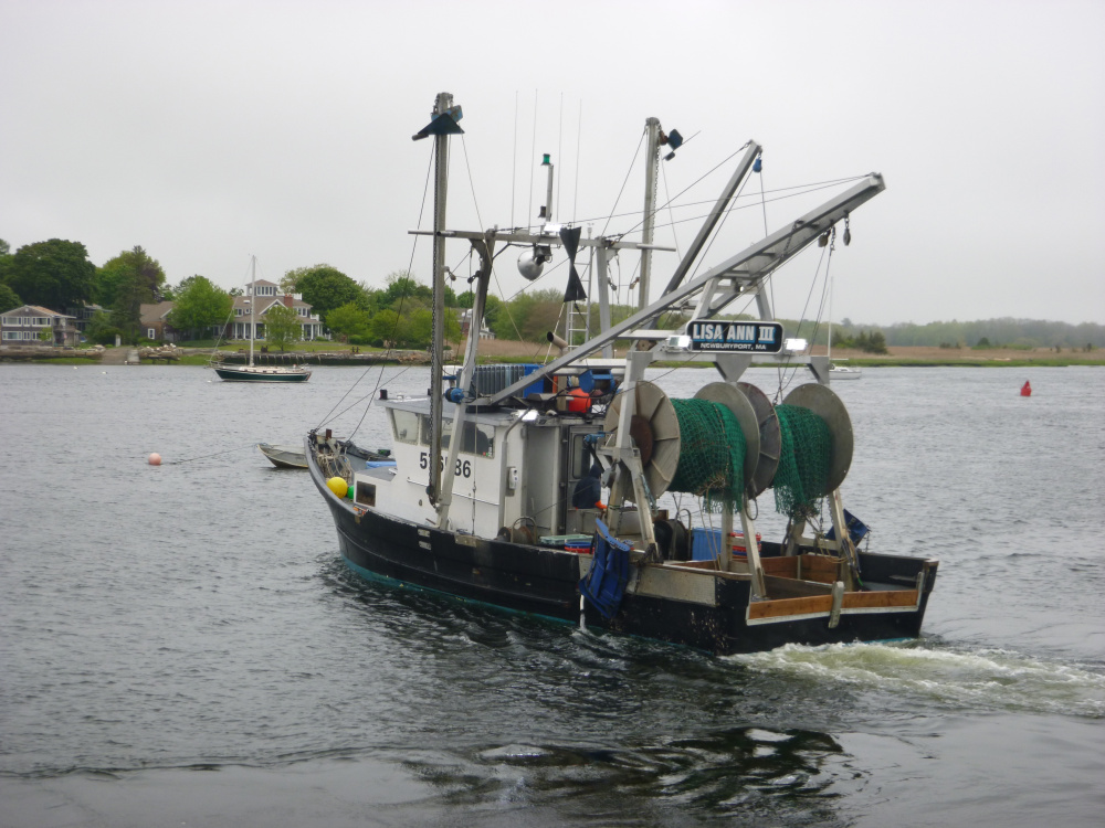 Fishing captain Jim Ford prepares to head to sea in the Lisa Ann III out of Newburyport, Massachusetts. Two net drums are fitted on the stern, so the ultra low opening trawl net and a traditional trawl can be testing alternatively.