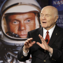 John Glenn talks with astronauts on the International Space Station via satellite in 2012. He said space travel strengthened his faith in God.