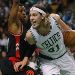 Boston's Kelly Olynyk goes around Toronto's Kyle Lowry in the second quarter Friday night in Boston.