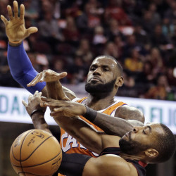 LeBron James is fouled by Miami's Wayne Ellington during Cleveland's 114-84 win Friday night. James climbed to ninth place on the NBA scoring list, passing Elvin Hayes.
