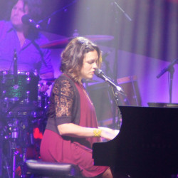 At ease on piano and guitar, Norah Jones shows her versatility Friday night at the  State Theatre while promoting her new album.