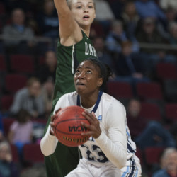 UMaine's Tanesha Sutton gets a shot of with pressure from Darmouth's Olivia Smith during first half Saturday at the Cross Insurance Center in Bangor. The Black Bears went on to a 60-55 win. (Kevin Bennett Photo)