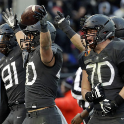 Army running back Andy Davidson (40) celebrates his touchdown with teammates in the first half of the Army-Navy football game in Baltimore on Saturday. Army upset Navy, 21-17. (Associated Press/Patrick Semansky)