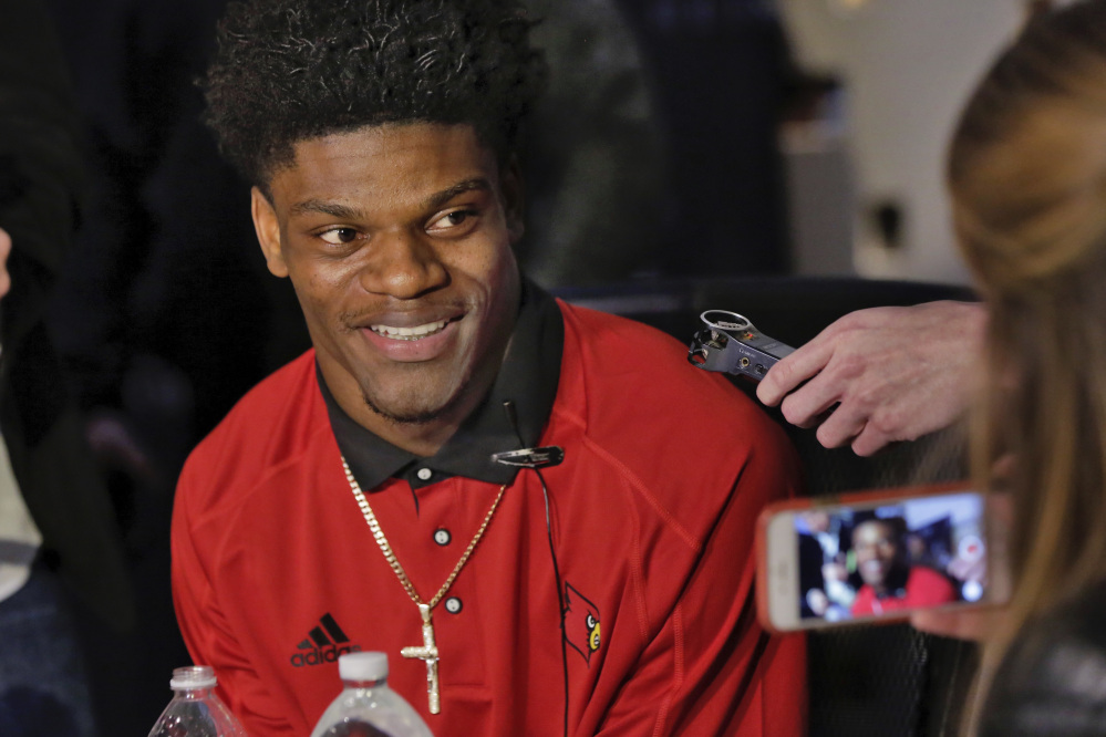 University of Louisville quarterback Lamar Jackson is interviewed during a Heisman Trophy media event in New York. (Associated Press/Richard Drew)