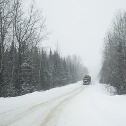 ALLAGASH, ME - FEBRUARY 9: A logging truck barrels down a woods road on land owned by Irving Woodlands in February. A spokeswoman at the Canadian consulate in Boston says both countries have an interest in reaching a negotiated agreement on the issue of tariffs and that Canada is committed to free trade.