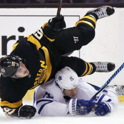 Boston's Noel Acciari falls on Toronto's Matt Marti during the first period of Saturday's game in Boston. Toronto won, 4-1. Associated Press/Michael Dwyer