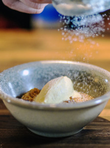 Chef Joshua Berry finishes a serving of Indian pudding and ice cream at Union restaurant in the Press Hotel.