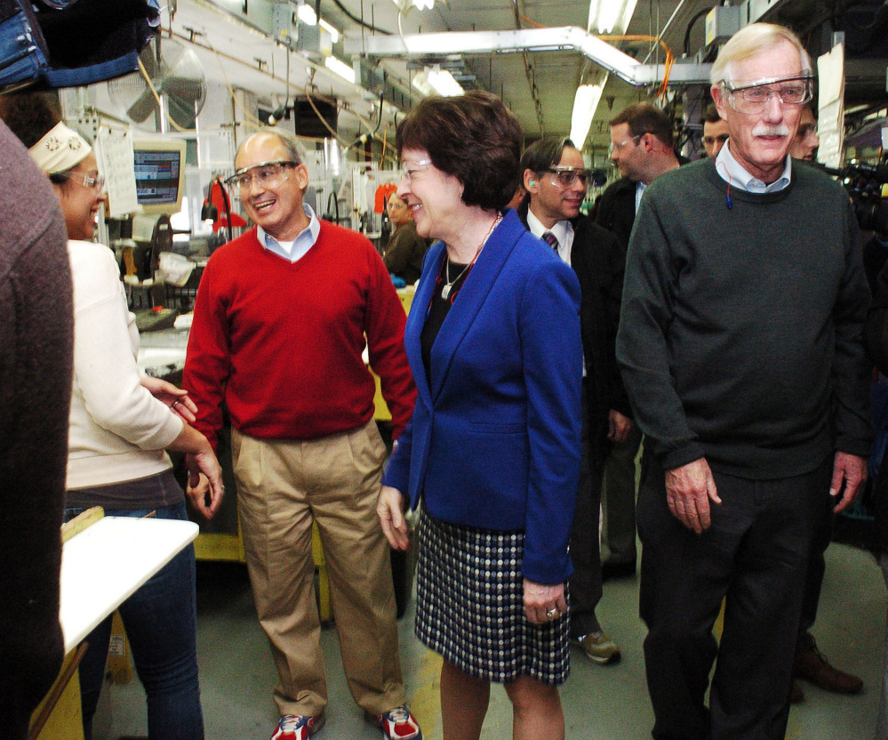 Rep. Bruce Poliquin, left, Sen. Susan Collins and Sen. Angus King tour the New Balance plant in Skowhegan on Wednesday.